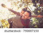 father carrying his girl on... | Shutterstock . vector #750007153