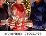 group of people celebrating new ... | Shutterstock . vector #750011419