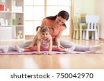 mother and kid daughter doing... | Shutterstock . vector #750042970