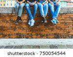 legs of four teenagers sitting... | Shutterstock . vector #750054544