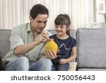 father and daughter putting...   Shutterstock . vector #750056443