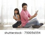 father and daughter sitting... | Shutterstock . vector #750056554