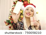 beautiful young woman with a... | Shutterstock . vector #750058210