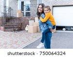 beautiful daughter piggyback... | Shutterstock . vector #750064324
