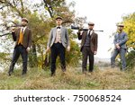 four dangerous gangsters hold... | Shutterstock . vector #750068524