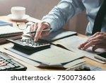 businessman working on desk... | Shutterstock . vector #750073606