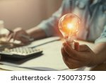 hand woman accountant holding... | Shutterstock . vector #750073750