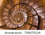 Small photo of Spiral stairs inside Arc de triomphe in Paris France - travel and architecture background