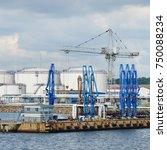 port cranes in oil terminal ... | Shutterstock . vector #750088234