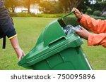 hand holding empty bottle into... | Shutterstock . vector #750095896
