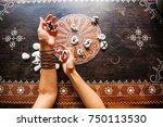 Hands Holding Runes Stones On...