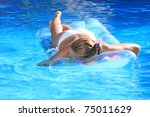young woman in the pool in... | Shutterstock . vector #75011629