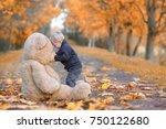 cute little boy kissing his... | Shutterstock . vector #750122680