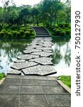 stone pathway across the pond... | Shutterstock . vector #750127930