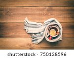 a cup of hot tea is wrapped in... | Shutterstock . vector #750128596