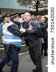 4th November 2017, London, United Kingdom:-Unidentified protester scuffles with a police officer at a pro Palestine rally - stock photo