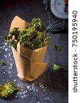 vegan kale chips with sea salt   Shutterstock . vector #750195940
