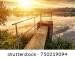 small lake with floodgate under ...   Shutterstock . vector #750219094