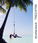 maldives woman swinging near... | Shutterstock . vector #750219700