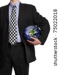 Business man holding a globe in his hand in a soccer ball pose symbol for global business, communications, teamwork or environmental conservation Credit to: http://visibleearth.nasa.gov - stock photo