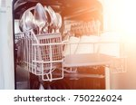 an open dishwasher with clean... | Shutterstock . vector #750226024