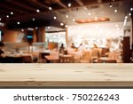 image of wooden table in front... | Shutterstock . vector #750226243