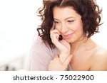 cute woman on the phone sitting ... | Shutterstock . vector #75022900