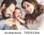 a mother father and baby child... | Shutterstock . vector #750291346