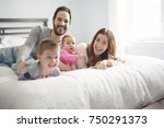 a family of four play on a... | Shutterstock . vector #750291373