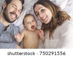 a mother father and baby child... | Shutterstock . vector #750291556
