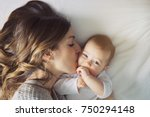 a mother and baby child on a... | Shutterstock . vector #750294148