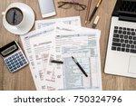 1040 tax form  laptop  glasses  ... | Shutterstock . vector #750324796