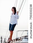woman standing on rail watching ... | Shutterstock . vector #750333238