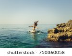 cliff jumping into the ocean at ... | Shutterstock . vector #750360058