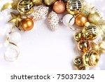 christmas balls on the snow.  | Shutterstock . vector #750373024