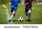children kicking soccer match... | Shutterstock . vector #750373036