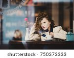 stunning curly woman in a coat... | Shutterstock . vector #750373333