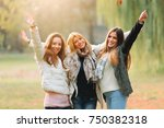 portrait of three smiling... | Shutterstock . vector #750382318