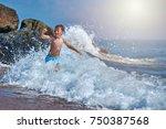 cute caucasian boy in sea waves.... | Shutterstock . vector #750387568