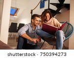 young couple looking at family... | Shutterstock . vector #750394273