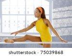 Ballet Dancer Stretching At Ba...