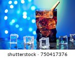 cola in drinking glass with ice ... | Shutterstock . vector #750417376