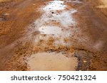 bad road  wet from rain snow... | Shutterstock . vector #750421324