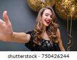 excited blonde girl with red... | Shutterstock . vector #750426244