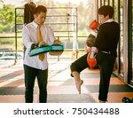 businessman practicing boxing... | Shutterstock . vector #750434488