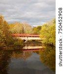 Small photo of Vertical photogrpah of the Academia Pomeroy Covered Bridge, across the Tuscarora River in Juniata County, Pennsylvania, on an autumn day.