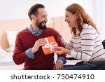 giving a present. gleeful... | Shutterstock . vector #750474910