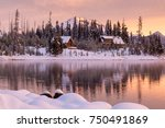 snowy cabins line the shore of... | Shutterstock . vector #750491869