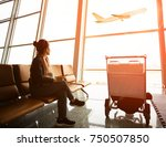 single woman sitting in airport ... | Shutterstock . vector #750507850