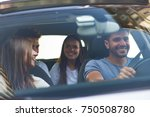 group of happy friends on a car | Shutterstock . vector #750508780